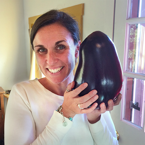 Megan Taft with a big eggplant