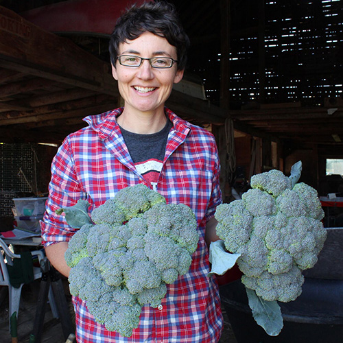 Sara Cawthon with fresh foods - big broccolis