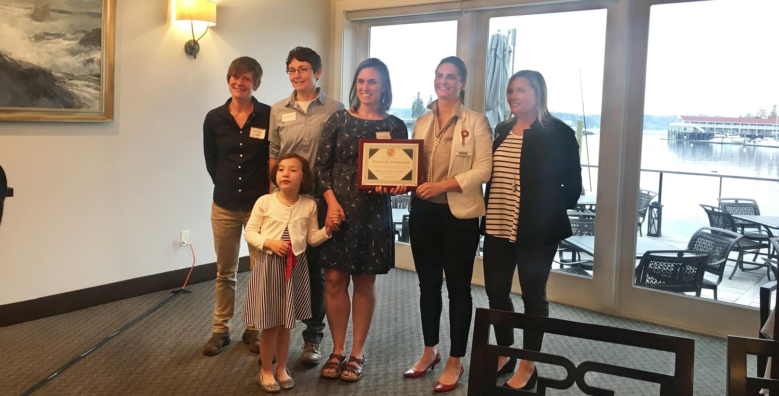 Meg, Sara, Kaitlyn and Adley receiving award