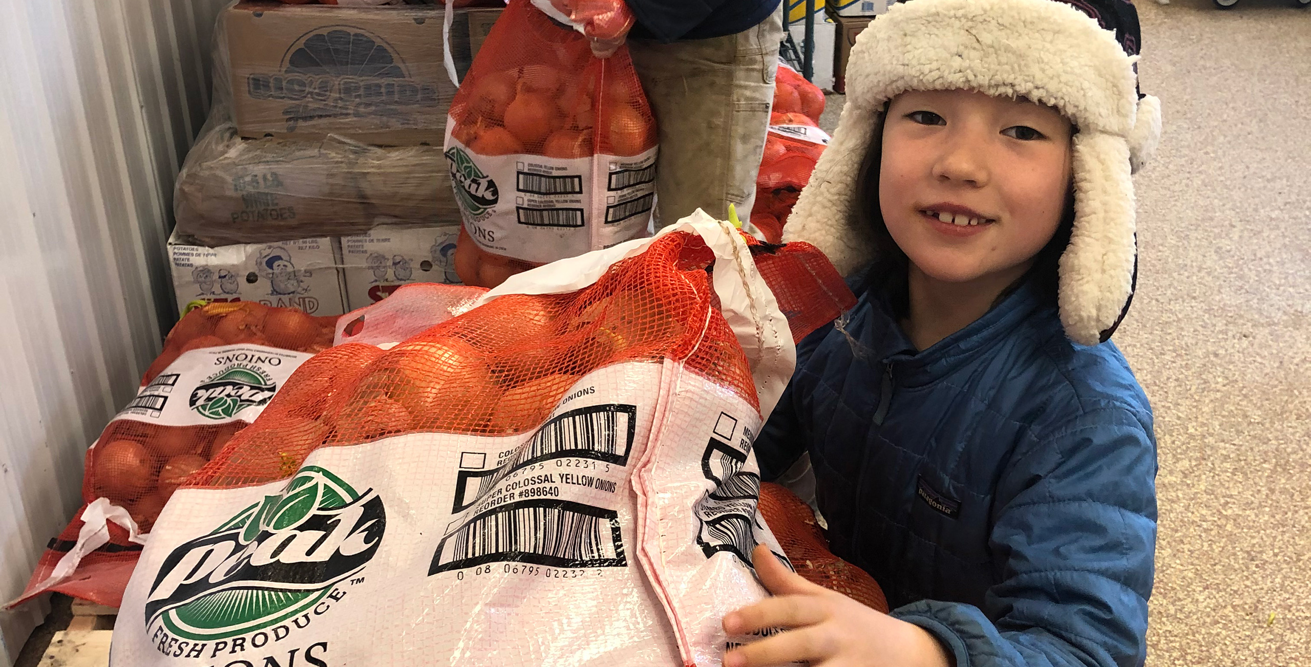Adley helps receive a shipment at the food storage hub